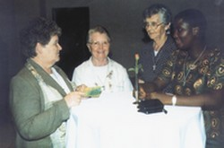 Srs. Kathleen Moran, Catherine McCrave, Kathleen Hickey and Vidah at the celebration in the Sheraton Hotel, Kampala