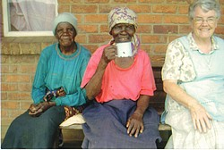 Sr. Louise (right) with residents