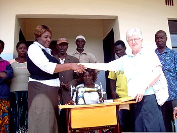 Books and sewing machines are handed over