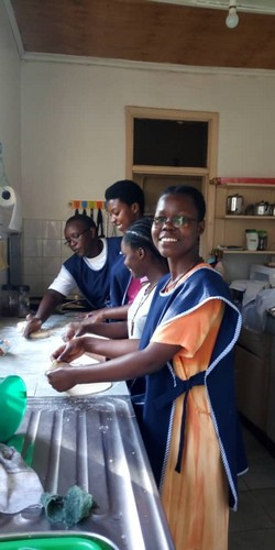 7. our postulants learning how to make chapatis.jpg