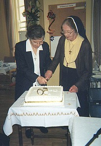 Srs. Francis and Anne Scott cut Jubilee Cake