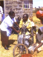 Sr. Pauline caring for person in wheelchair