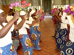 Colourful dancers holding flowers